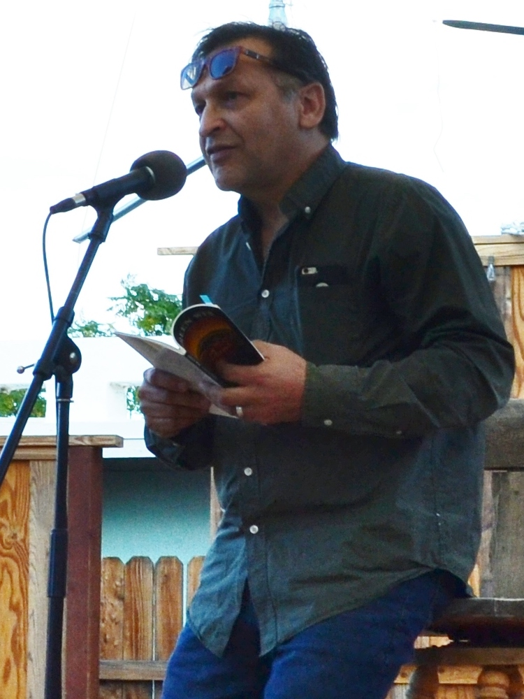Juan Delgado reading at Cholla Needles