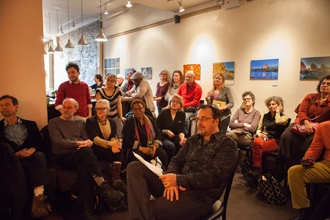 <p>A crowd listens to poets Cornelius Eady and Jean Monahan read at the Lunar Walk Reading Series at Two Moon Art House and Cafe in Brooklyn, New York, on February 10, 2013.</p>