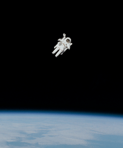 Captured in 1984, the image shows astronaut Bruce McCandless floating far above the earth, making history as the first person to complete a spacewalk without being tethered to a spacecraft.