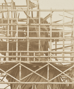 Archival image of the Statue of Liberty surrounded by scaffolding