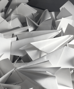 A paper sculpture constructed of paper planes