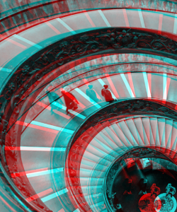 Bird's-eye view of a spiral staircase; photo appears with an anaglyph effect